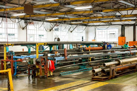 Johannesburg, South Africa - October 19, 2012: Inside interior of a rubber and pipe fabrication assembly line in a factory Editorial