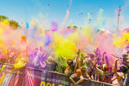 Johanneburg, South Africa,  09/25/2016, Young people having fun at The Color Run 5km Marathon, Bright color paint all over a large crowd