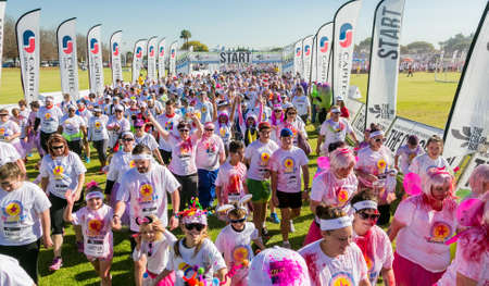 Johannesburg, South Africa, May 21, 2017, Diverse people running in The Color Run Marathon in Johannesburg