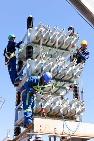 Johannesburg, South Africa - April 11 2012: Electricians working on high voltage power lines