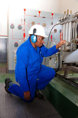 Johannesburg, South Africa - April 11 2012: Electrical Engineer checking gauge equipment