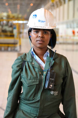 Johannesburg, South Africa - April 12 2012: Female Technician in turbine room at Coal Burning Power Station Redactioneel