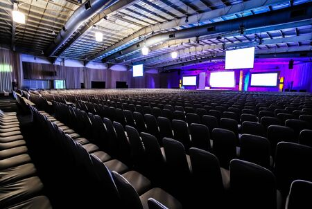 Rows of empty chairs in large Conference hall for Corporate Convention or Lecture 版權商用圖片
