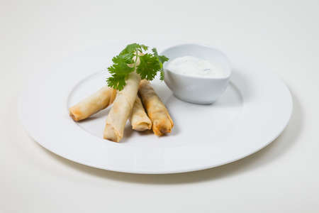 Spring Rolls and dip on a white plate on a white background isolated Stok Fotoğraf