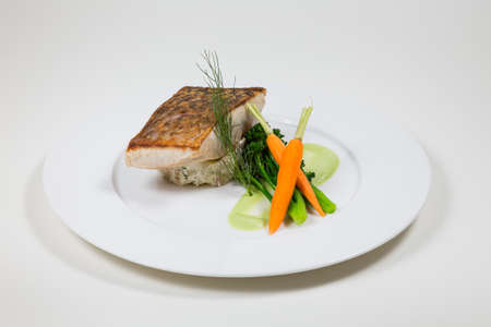 Fish course on a white plate