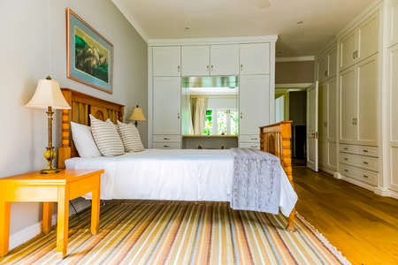 Cape Town, South Africa - February 6, 2020: Inside interior of bedroom with wooden floors in up-market house in the suburbs