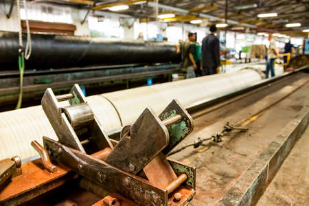 Johannesburg, South Africa - October 19, 2012: Inside interior of a rubber and pipe fabrication assembly line in a factory Redakční
