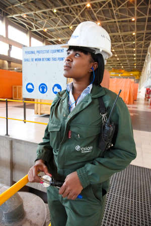 Johannesburg, South Africa - April 12 2012: Female Technician in turbine room at Coal Burning Power Station Sajtókép