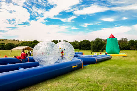 Johannesburg, South Africa - November 25, 2012: Inflatable water slides and other activities at outdoor kids fun park