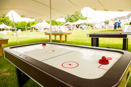 Johannesburg, South Africa - November 25, 2012: Table Hockey and other games under a tent in a park for recreation