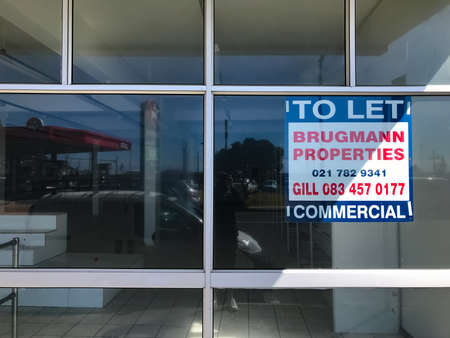 Cape Town, South Africa - December 4, 2020: Empty retail stores on high street closed down due to recession and pandemic related causes