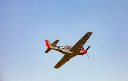 Johannesburg, South Africa - May 22, 2011: World War 2 US Air-Force Mustang fighter plane flying through the air