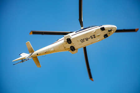 Johannesburg, South Africa - May 22, 2011: Luxury Helicopter flying through the air over Johannesburg airspace Editorial