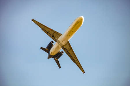 Johannesburg, South Africa - May 22, 2011: Commercial Jet Airplane flying overhead on a sunny day with clear skies