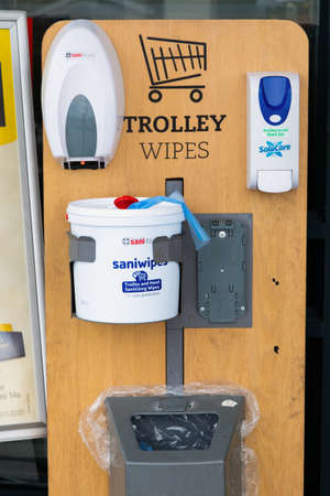 Cape Town, South Africa - December 10, 2020: Hand Sanitizer and trolley wipes outside Pick n Pay grocery store for the prevention of the spread of virus Editorial