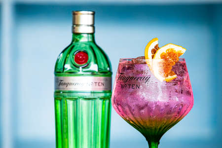 Cape Town, South Africa - December 14, 2020: Illustrative Editorial of Tanqueray Gin bottle and cocktail on bar counter