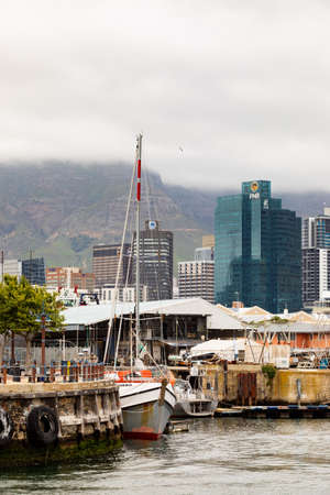 Cape Town, South Africa - December 14, 2020: Various kinds of boats in VA Waterfront Harbor on a cloudy day Editorial