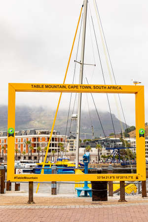 Cape Town, South Africa - December 14, 2020: Yellow Rectangle photo frame for tourist photos at the VA Waterfront