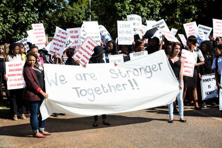 Johannesburg, South Africa - April 30, 2015: Staged Woman's protest march in suburban street to be used in music video for charity purposes
