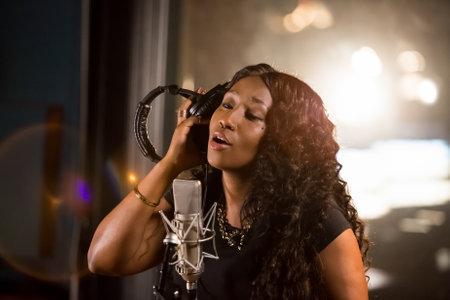 Johannesburg, South Africa - April 29, 2015: Victoria Kimani, Kenya singer recording vocal part on Afro-pop song in studio Editorial
