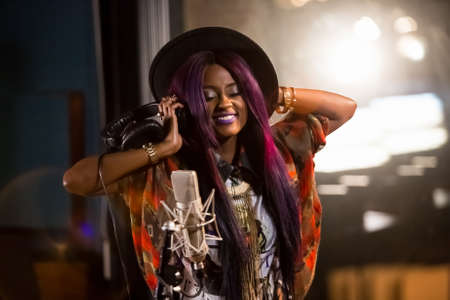 Johannesburg, South Africa - April 29, 2015: Vanessa Mdee, Tanzania singer recording vocal part on Afro-pop song in studio Editorial