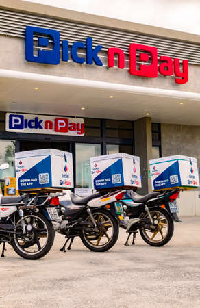 Cape Town, South Africa - December 10, 2020: Express Service home delivery bikes parked outside local Pick n Pay grocery store Editorial
