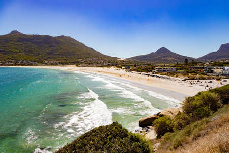 Hout Bay beach and harbour in the background in Cape Town, South Africa