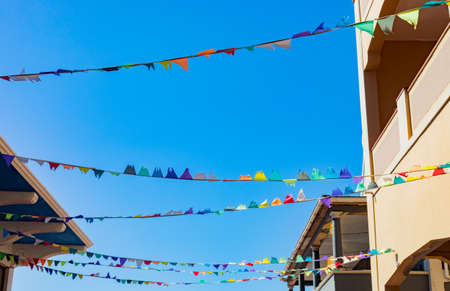 Cape Town, South Africa - March 23, 2021: Bunting in Quiet high-street of small coastal town of Muizenberg