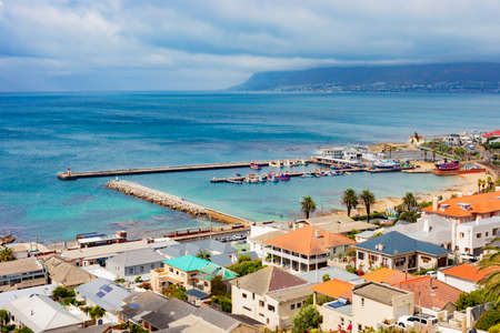 Cape Town, South Africa - March 10, 2021: Elevated view of Kalk Bay Harbour in False Bay, South Africa