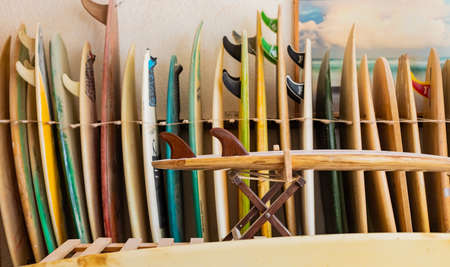 Cape Town, South Africa - March 23, 2021: Retro vintage surfboards lined up in a local surf shop