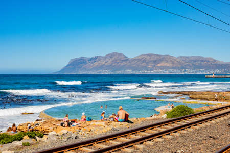 Cape Town, South Africa - March 23, 2021: Passenger rail running through small coastal town of St James