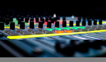 Close up of Sliders and buttons on Audio Mixing Desk at live event Stock Photo