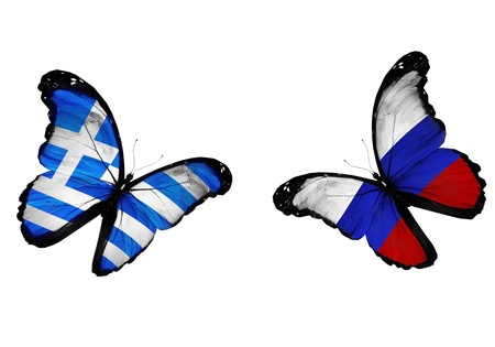 Concept - two butterflies with Greek and Russian flags flying, like two football teams playing   photo