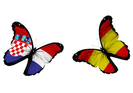 Concept - two butterflies with Spanish and Croatian flags flying, like two football teams playing   photo