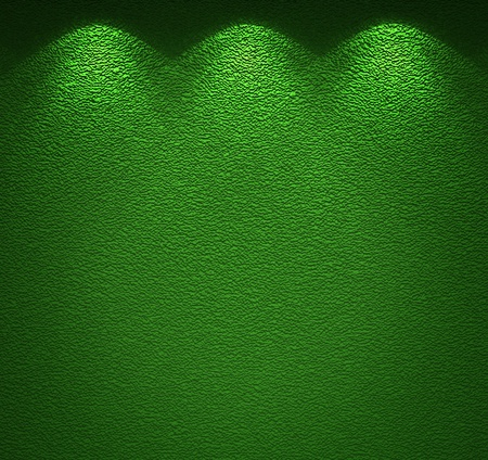 backround: Illuminated texture of the green wall