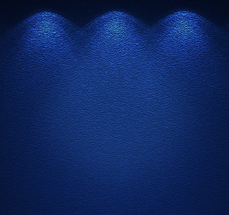 backround: Illuminated texture of the blue wall