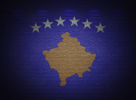 Kosovo flag wall, abstract grunge background photo