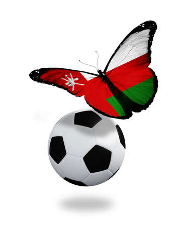 ball like: Concept - butterfly with Omani flag flying near the ball, like football team playing   Stock Photo