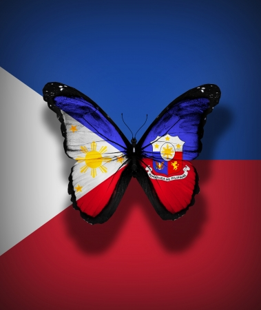 Philippines flag butterfly with coat of arms, isolated on flag background photo