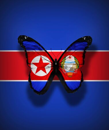 North Korea with coat of arms flag butterfly, isolated on flag background photo
