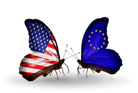 Two butterflies with flags on wings as symbol of relations USA and EU photo