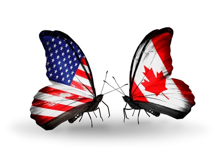 Two butterflies with flags on wings as symbol of relations USA and Canada Zdjęcie Seryjne