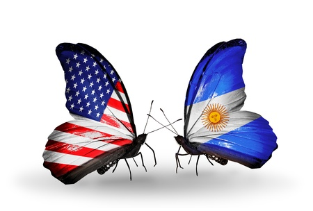 Two butterflies with flags on wings as symbol of relations USA and Argentina photo