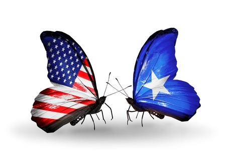 somalian: Two butterflies with flags on wings as symbol of relations USA and Somalia Stock Photo