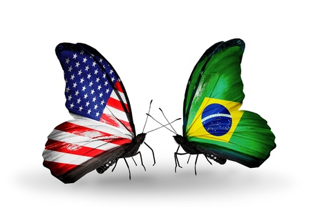 Two butterflies with flags on wings as symbol of relations USA and Brazil