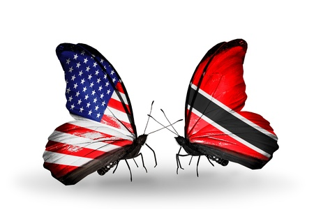 Two butterflies with flags on wings as symbol of relations USA and Trinidad and Tobago Stock Photo