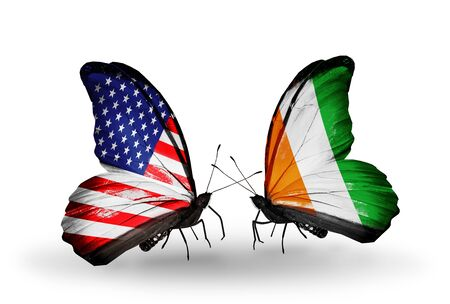 cote d ivoire: Two butterflies with flags on wings as symbol of relations USA and Cote d