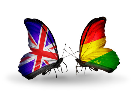 Two butterflies with flags on wings as symbol of relations UK and Bolivia photo