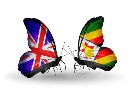 Two butterflies with flags on wings as symbol of relations UK and Zimbabwe photo