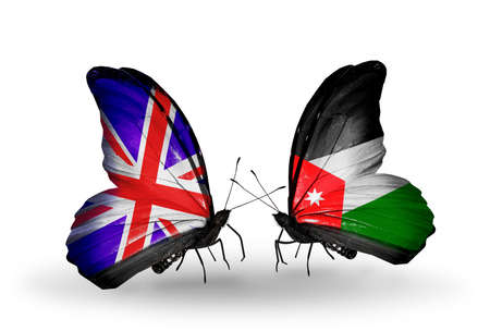 Two butterflies with flags on wings as symbol of relations UK and Jordan photo